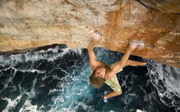 Chris Sharma rock climbing / deep water soloing in Mallorca, Spain.