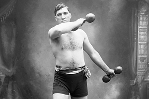 Boxer Jess Willard Exercising with Dumbbells