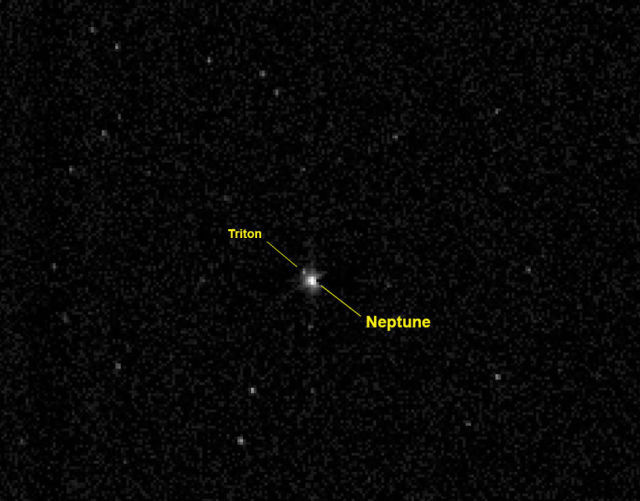 Нептун и его спутник Тритон.