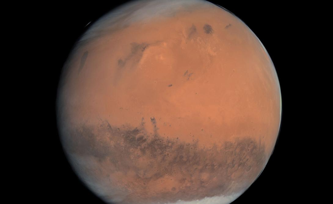 Марс. Снимок принадлежит все той же Розетте — фотография была сделана на пути аппарата к комете Чурюмова-Герасименко.