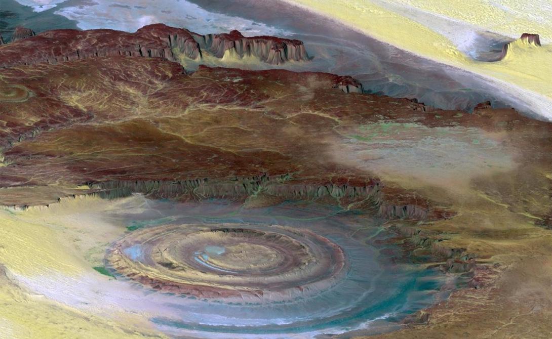 Ришат, также известный как Глаз Сахары, выглядит как центр огромной мишени. Диаметр этого образования — почти 60 километров. Ученые считают, что перед нами образчик эразивных процессов, протекающих в глубине песков.