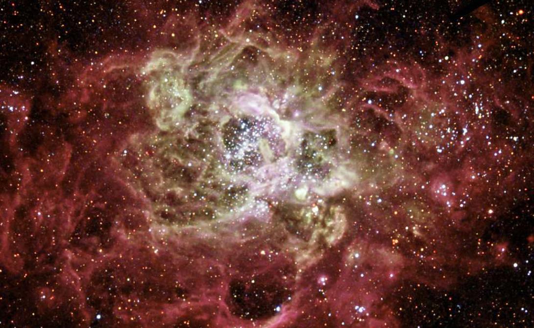 NGC 604 Туманность NGC 604 составлена из более чем 200 невероятно горячих солнц. Космический телескоп Хаббл захватил блестящую флуоресценцию туманности, вызванную ионизованным водородом.