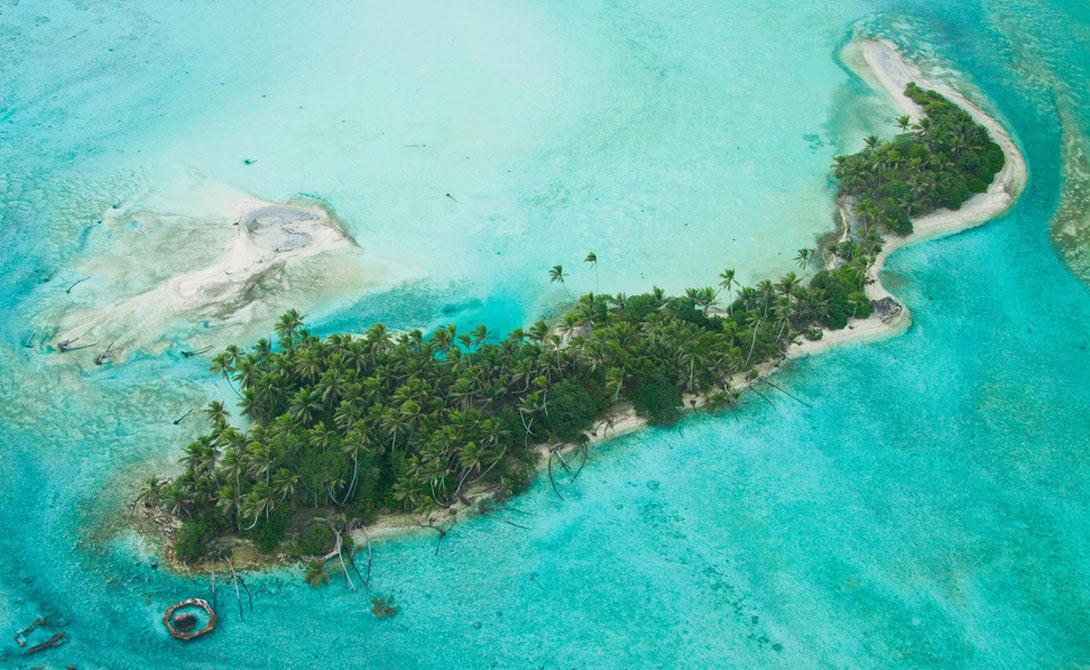 Атолл Пальмира США Атолл Пальмира находится между Гавайями и Американским Самоа. Целых пятьдесят небольших островков покрыты кокосовыми деревьями, сцеволой и пизонией.