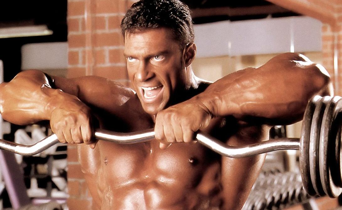Тяга штанги к подбородку А вот тяга к подбородку станет отличным упражнением, влияющим на максимально быстрое развитие массы и объема плеч. При правильном выполнении повтора, в работу включаются задние и средние дельты. Таким образом, вы значительно расширяете спину.
