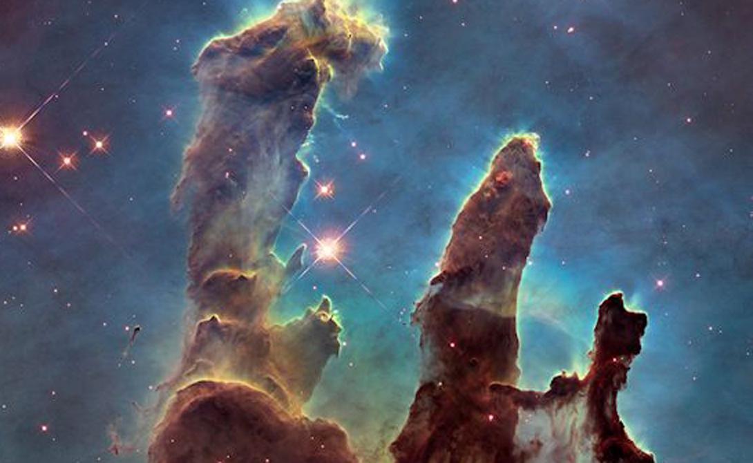 Столпы Творения Три мертвенно-холодных столпа газовых облаков окутывают звездные скопления в туманности Орла. Это один из самых известных снимков телескопа, получивший название «Столпы Творения».