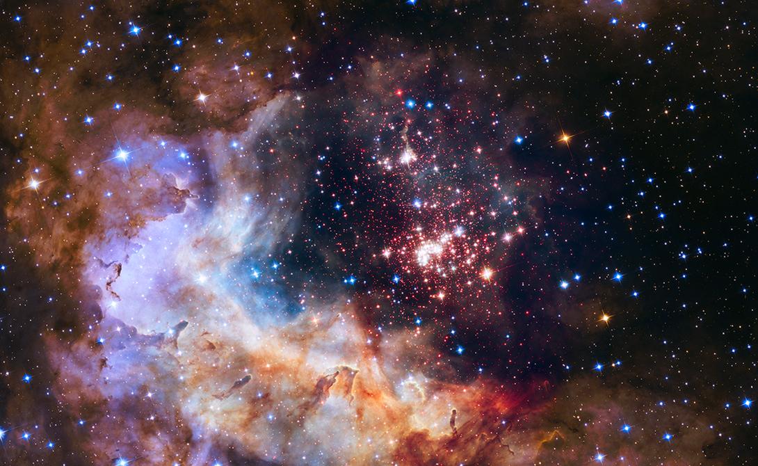 Небесный фейерверк Внутри снимка можно разглядеть множество молодых звезд, собравшихся в туманной дымке космической пыли. Колонны, состоящие из плотного газа, становятся инкубаторами, где зарождается новая космическая жизнь.
