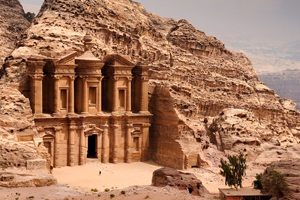 There is a person by the doorway to get a scale of the size. A classic view of El Deir, The Monastery in Petra. Shown in the context of the mountain that the facade was carved out of by the Nabataeans in the 1st century. The facade measures 50 metres wide by approximately 45 meters high.